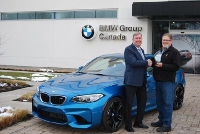 BEST NEW PREMIUM SPORTS / PERFORMANCE CAR  BMW M2, with 658 points, and scoring highest in Value. 2nd place Porsche 911 (Carrera 4S) with 656 points. 3rd place Mercedes-AMG C-Class Coupe (AMG C 63 S) with 648 points. (Left: Hans Blesse, President and CEO of BMW Group Canada, Right: David Taylor, CCOTY Committee Member) (CNW Group/Automobile Journalists Association of Canada)