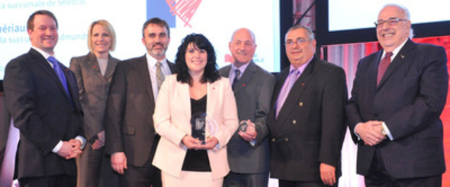 From left to right: Louis Vachon, National Bank's President and Chief Executive Officer; Karen Leggett, Executive Vice-President - Marketing; Gérald Melanson, Branch Manager, Shédiac; Chantal Thériault, Branch Manager, Edmundston; Claude Allaire, retired employee; Léo Godin, retired employee and André Bérard, National Bank's former President who inspired the Award. (CNW Group/National Bank of Canada)