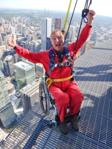 On Friday August 7, 2015, at the CN Tower, Paralympian Rick Hansen joined by Olympian Alexa Komarnycky and Paralympian Carla Qualtrough launch the accessible wheelchair EdgeWalk experience on the World's Highest Outdoor Walk on a Building (Guinness World Record) 356m/1168feet above Toronto. The TORONTO 2015 Parapan Am Games start today and run through August 15. (CNW Group/CN Tower)