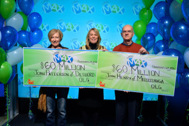 OLG's Vice President of Lottery Marketing and Sales Wendy Montgomery hands out a record breaking $120 million in lottery prizing at one time at the OLG Prize Centre Wednesday. John Henry of Mississauga won the December 25, 2015 $60 million LOTTO MAX jackpot and Joan Patterson of Desboro won the February 5, 2016 $60 million LOTTO MAX jackpot. (CNW Group/OLG Winners)
