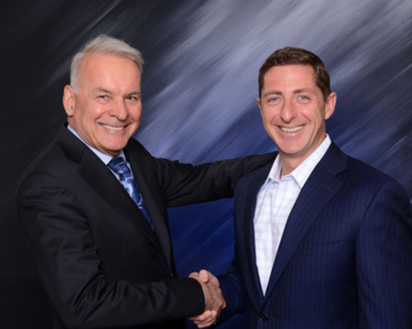 Mr. Alain Bouchard, President and Chief Executive Officer with the Chief Operating Officer, Mr. Brian Hannasch (CNW Group/Alimentation Couche-Tard Inc.)