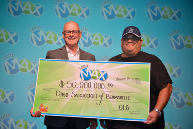 OLG's COO Greg McKenzie presents Beamsville resident Dino Salciccioli his $50 Million LOTTO MAX cheque at the OLG Prize Centre in Toronto (CNW Group/OLG Winners)