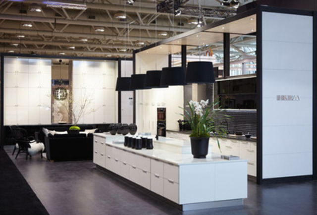 The IKEA booth at the 2012 Interior Design Show in Toronto is inspired by the classic fashion combination of a black dress and pearls. The booth features their newest offer in high-gloss cream and black glass door styles. (CNW Group/IKEA Canada)