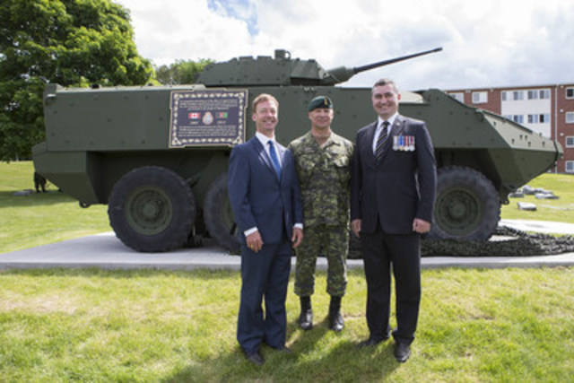 Shawn Deane, Project Manager, LAV III Monument Program, Colonel Daniel MacIsaac, Commander 5th Canadian Division Support Base Gagetown and Fredericton West-Hanwell MLA Brian MacDonald joined Canada Company to unveil the first Light Armoured Vehicle monument (LAV III) at the Cenotaph in Oromocto, New Brunswick on Wednesday, June 22, 2016. (CNW Group/Canada Company)