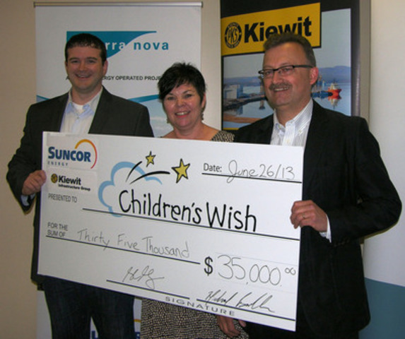 Mike Buckle (L) with Peter Kiewit Infrastructure Co., and Stewart Strong (R) of Suncor, present cheque to Edie Newton, Newfoundland and Labrador Chapter Director, The Children's Wish Foundation of Canada. (CNW Group/The Children's Wish Foundation of Canada)
