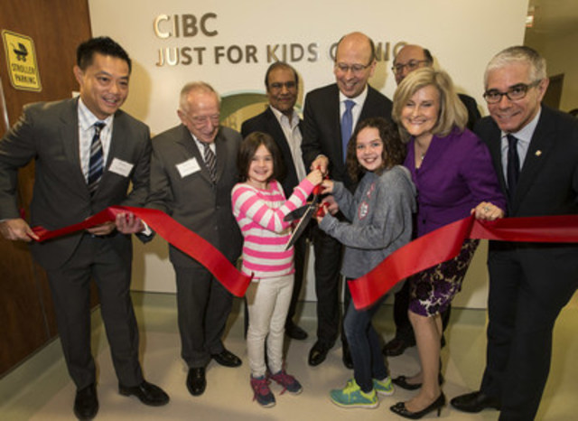 Victor Dodig, CIBC CEO, Dr. Eddy Lau, Chief of Paediatrics, (far left) and Maria Dyck, President and CEO, St. Joseph's Health Centre Foundation help cut the ribbon to open the newly renovated CIBC Just for Kids Clinic with doctors, patients and staff at St. Joseph's Heath Centre. (CNW Group/St. Joseph's Health Centre Toronto)