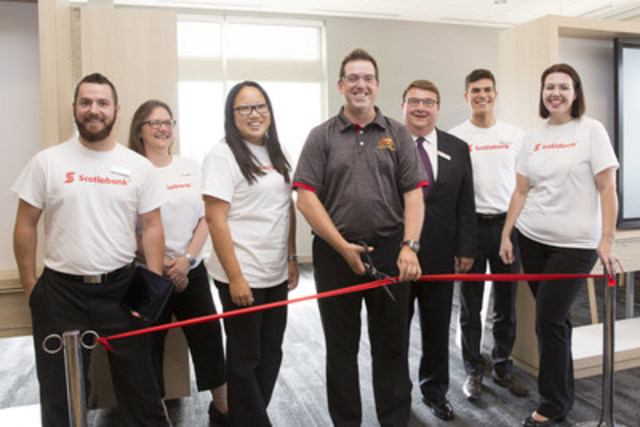 Mayor Cam Guthrie of Guelph, Stephen Gaskin (SVP, Ontario Region, Scotiabank) as well as Scotiabank employees and customers celebrate the grand opening of Scotiabank Solutions, an innovative advice and learning branch, in Guelph, Ontario. The new open concept branch format offers customers a personalized banking experience. (CNW Group/Scotiabank)