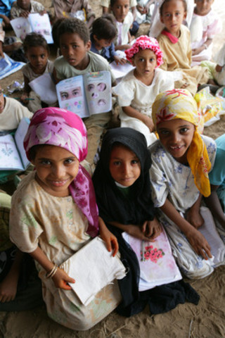 Students hold-up their UNICEF-provided lesson books at a school in Yemen. This Valentine's Day, show your love by purchasing a UNICEF Survival Gift - a heart-warming present for you and your sweetheart, and a life-changing gift for a child in need. www.unicef.ca/survivalgifts (CNW Group/UNICEF Canada)