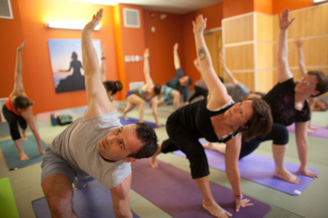 Participants at 137 Yonge Street GoodLife Fitness hold a Yoga post during a special YogaFit class lead by YogaFit Creator Beth Shaw. (CNW Group/GoodLife Fitness)