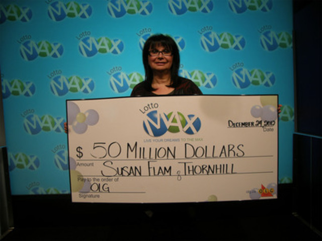 Susan Flam of Thornhill with her $50 million LOTTO MAX cheque at the OLG Prize Centre in Toronto. (CNW Group/OLG Winners)