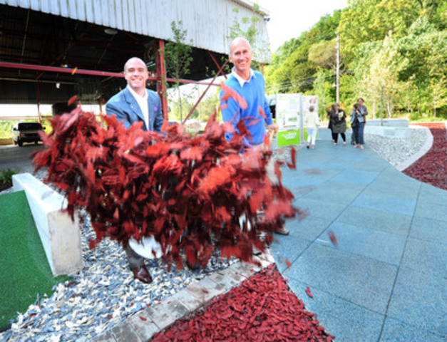 Andrew Horsman, Executive Director of Ontario Tire Stewardship (OTS) (left) and Geoff Cape, CEO, Evergreen Brick Works (right) lay rubber mulch on a new landscape site at Evergreen Brick Works. Built with recycled tire products, the site is the winning design of two Humber College students who won the first annual OTS Student Design Competition (CNW Group/Ontario Tire Stewardship)
