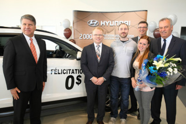 In celebration of the 2-millionth Hyundai vehicle sold in Canada, (from l to r) Hyundai Auto Canada Corp. President and CEO Don Romano and Director of Sales Steve Milette surprised customers Jean-Francois Belanger and Melissa Baker with a free 5-year lease of their white 2016 Tucson compact SUV. They were accompanied by François Trudeau, District Sales Manager with Hyundai Auto Canada, and Denis Michel, Dealer Principal with Hyundai Val-Bélair in Quebec. (CNW Group/Hyundai Auto Canada Corp.)