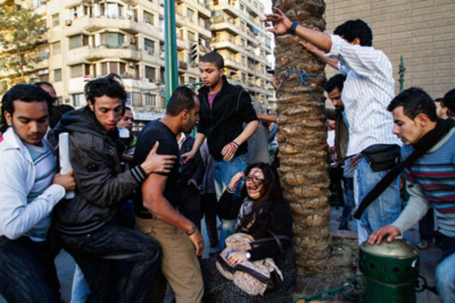 From Eman Helal's photo essay Just Stop: Egyptian woman assaulted in Tahir Square, Cairo, during a march for International Women's Day 2011. Some men around her were the harassers and others were trying to rescue her. (CNW Group/Canadian Journalism Forum on Violence and Trauma)