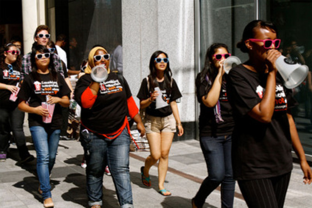 """In a flash mob organized during the Toronto International Film Festival, youth show movie fans they are """"TIFFed that smoking in movies is not being addressed as a serious public health issue (CNW Group/Youth Health Action Network)"""