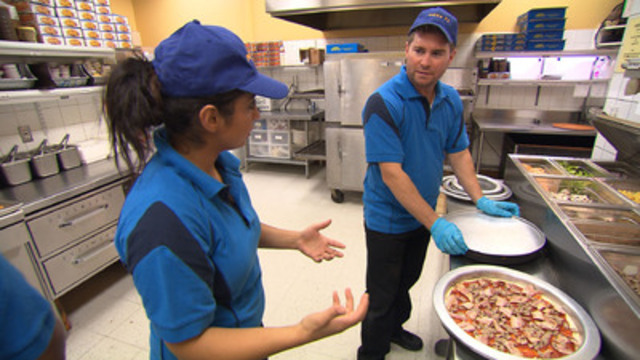Pizza Pizza CEO, Paul Goddard, incognito at a Pizza 73 franchise. (CNW Group/W Network)