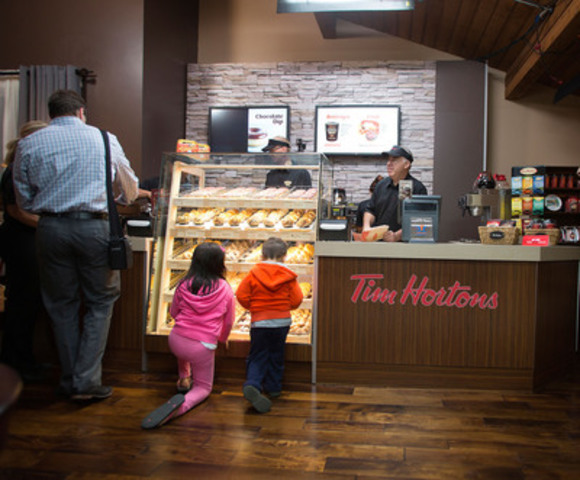 Tim Hortons transformed a home in Calgary overnight into The Tims Next Door to kick-off the launch of its new creative campaign in support of recruitment. The company hopes to hire more than 5,000 team members in restaurants across Canada. (CNW Group/Tim Hortons)