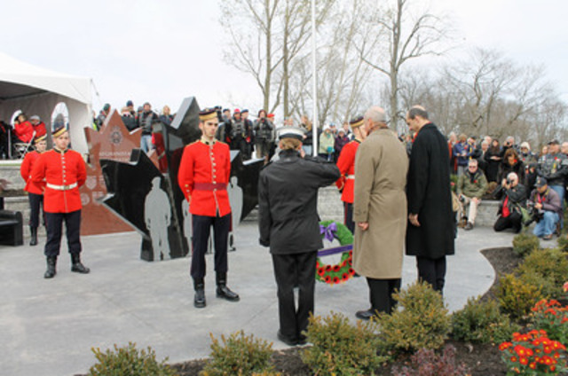 Minister Blaney and MP Rick Norlock lay a wreath at the new Afghanistan Repatriation Memorial in Trenton, Ontario (CNW Group/Veterans Affairs Canada)