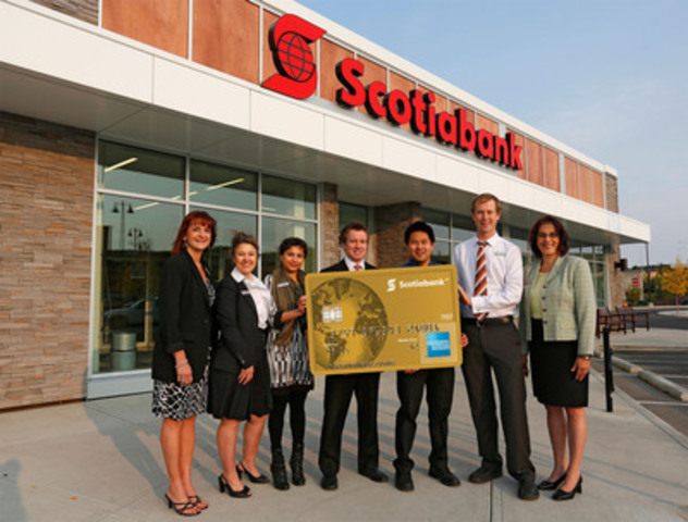 Just landed! Scotiabank employees at the Aspen Woods branch in Calgary, Alberta celebrate the arrival of the new Scotiabank American Express® Cards - a suite of loyalty cards designed for travel enthusiasts. (CNW Group/Scotiabank - Products & Services)