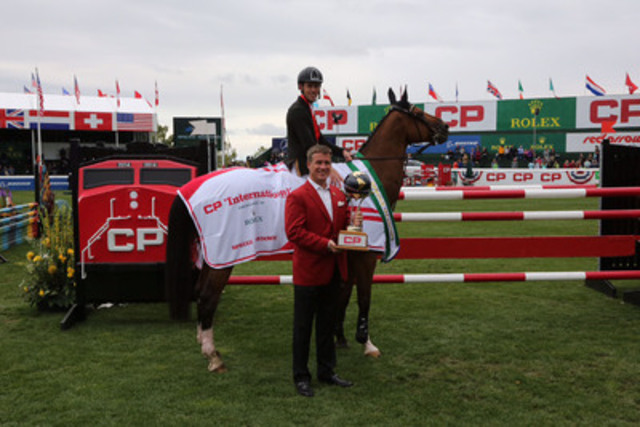 CP President and Chief Operating Officer Keith Creel presents the CP International trophy to Great Britain's Scott Brash. Brash had two clear rounds on his way to victory, helping CP raise $155,000 for the Alberta Children's Hospital Foundation in the process. (CNW Group/Canadian Pacific)