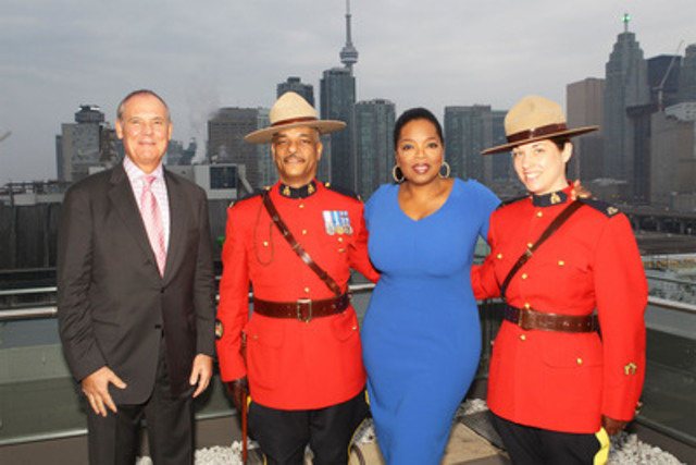 Oprah Winfrey greeted by Corus Entertainment's President and CEO John Cassaday and the Royal Canadian Mounted Police outside Corus Quay in Toronto, Canada on Sunday, April 15. (L-R: Corus Entertainment's President and CEO John Cassaday; Staff Sergeant Major, Robert Akin; Oprah Winfrey; Constable Jann Saccaro) (CNW Group/Oprah Winfrey Network)