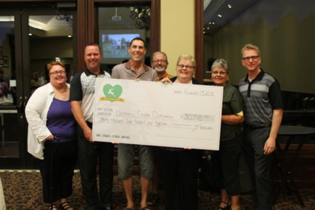 Distress Centre Durham receives a giant cheque with a giant value! (CNW Group/Coughlan Homes)