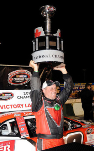 Scott Steckly with the NASCAR Canadian Tire Series National Champion trophy. (CNW Group/Wide Open Motorsport Solutions Inc.)