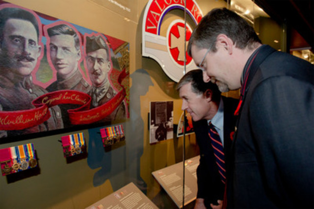 Eric Clarke and Doug Cargo admire the new display of three Victoria Cross Medals awarded during the First World War to residents of Winnipeg's Valour Road. Mr. Clarke and LCol (Rtd) Cargo are the great-nephews of Corporal Lionel B. Clarke and Company Sergeant Major Frederick William Hall. (CNW Group/Canadian War Museum)