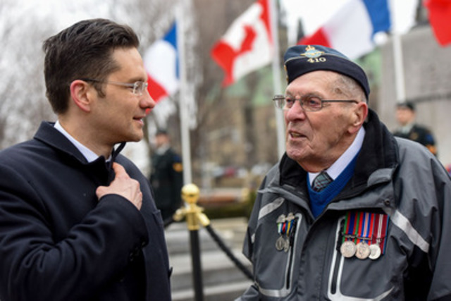 The Honourable Pierre Poilievre, Minister of Employment & Social Development and Minister of Democratic Reform, speaks with Veteran John Newell following a ceremony marking the 98th anniversary of the Battle of Vimy Ridge at the National War Memorial in Ottawa. (CNW Group/Veterans Affairs Canada)