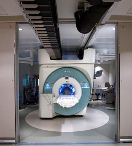 The VISIUS Surgical Theatre at Le Bonheur Hospital in Memphis, TN, installed in January 2011, features an intraoperative MRI that moves between operating and diagnostic rooms on ceiling rails. A study at the hospital is crediting the iMRI with reducing resurgery rates. (CNW Group/IMRIS Inc.)