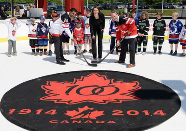 Bal Gosal, Minister of State (Sport) and Jim Hornell, Chairman of the Hockey Canada Board of Directors face-off during the official puck drop with Jennifer Botterill, three-time Olympic gold medalist at Hockey Canada's 100th Anniversary celebration in Toronto on June 26, 2014 at the MasterCard Centre for Hockey Excellence. Hockey Canada's Century Tour will travel across Canada visiting 100 communities to celebrate the sport. The first stop of the Century Tour will be on Canada Day in Ottawa. (CNW Group/Hockey Canada)