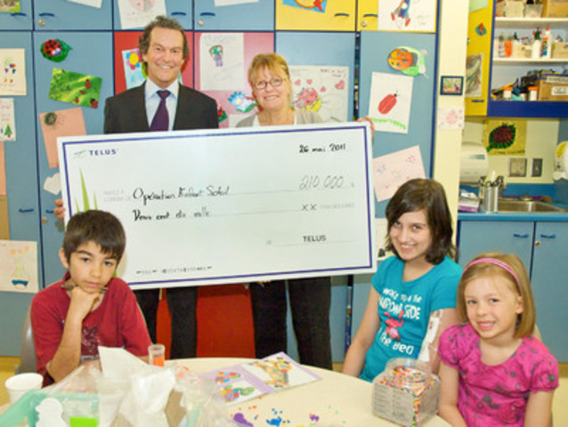 TELUS applies innovative cause marketing initiatives that enable our customers to support local organizations when subscribing to Optik TV, or purchasing smartphones and other devices. Through these campaigns, TELUS has donated $560,000 to Opération Enfant Soleil between 2010 and 2012. In this photo: Jean-François St-Germain (TELUS) and Ginette Charest (Opération Enfant Soleil).(CNW Group/TELUS Corporation)