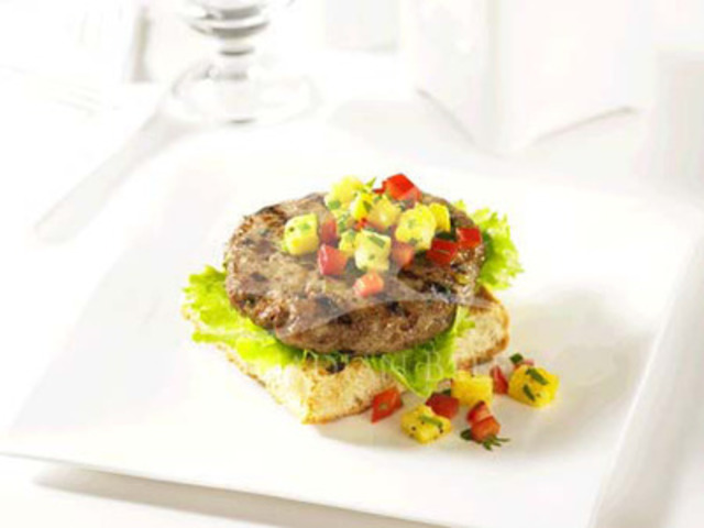 All dressed up with one of the Terrific Toppers featured in this recipe for Asian Beef Burgers and these beef burgers make a most memorable meal! (CNW Group/Canada Beef Inc.)