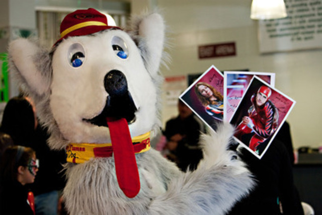 Calgary Flames mascot Harvey the Hound holds up autographed photos of Olympic athletes at the 2010 CE Franklin 3-on-3 Challenge (CNW Group/CE Franklin Ltd.)