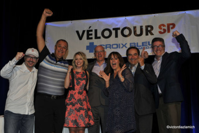 Participants Martin Legault and Richard Lemire, Valérie Chevalier, spokesperson for the Medavie Blue Cross MS Bike, Pierre Marion, Senior Director, Sales and Business Relations, Medavie Blue Cross, Patricia Paquin, spokesperson for the Medavie Blue Cross MS Bike, Louis Adam, Executive Director of the Multiple Sclerosis Society of Canada, Quebec Division, and François Coupal, Chairman of the Board of Directors of the Multiple Sclerosis Society of Canada, after they announced the amount raised. (CNW Group/Multiple Sclerosis Society of Canada)