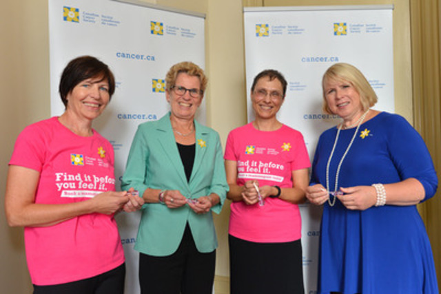 Ontario Premier Kathleen Wynne and Health Minister Deb Matthews receive a Thing-a-ma-boob key chain from breast cancer survivors and Women to Women ambassadors Ruth Ackerman (left) and Janice Hodgson to kick off the Canadian Cancer Society's new Women to Women movement at Queen's Park on October 1. (CNW Group/Canadian Cancer Society (Ontario Division))