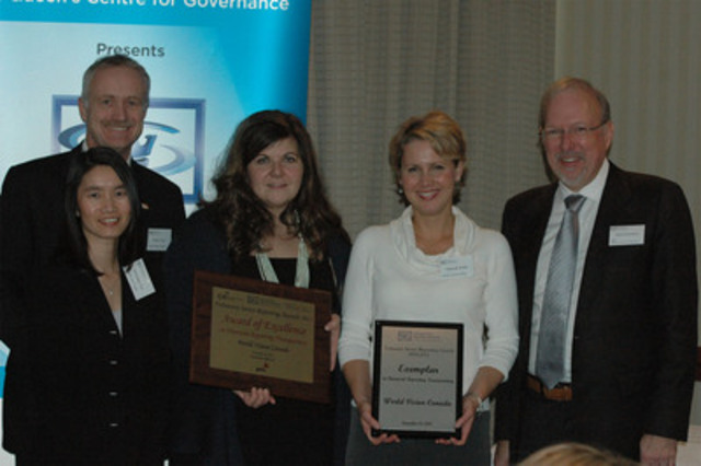 The attached photograph was taken at the awards luncheon, held at the Novotel, North York on Friday, November 18, 2011. Pictured from left to right are; from World Vision - Bernadine Yee, Director, Corporate Services, Charlie Fluit, CFO / VP Corporate Finance, Caroline Riseboro, Vice President, Public Affairs, Deborah Wolfe, Editor, External Communications, from Queen's University School of Business, David Saunders, Dean. (CNW Group/World Vision Canada)