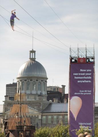 Un casse-cou tente d'établir un nouveau record de slackline au-dessus du Vieux-Montréal - Hemovel brise le tabou entourant une condition qui affecte des millions de Canadiens (Groupe CNW/Hemovel)
