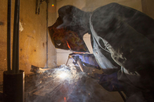 Abigail Lopes, 16, uses an Arc Welder following CWB Group's announcement of ACORN Canada's first ever national end-to-end welding program at Western Technical School in Toronto on May 19, 2015. Photo by Pawel Dwulit (CNW Group/CWB Group)