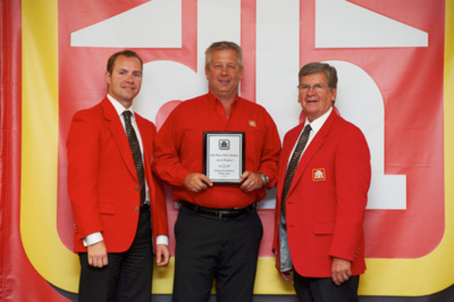 Rob Wallace, Public Relations & Promotional Events Manager, Home Hardware Stores Limited, Rick Kurzac, Dealer-Owner, Kamloops Home Hardware Building Centre, and Paul Straus, President and CEO, Home Hardware Stores Limited pose with the Paul Straus Public Relations award, which is distributed to Home Hardware Dealers for outstanding commitment to the community. (CNW Group/Home Hardware Stores Limited)