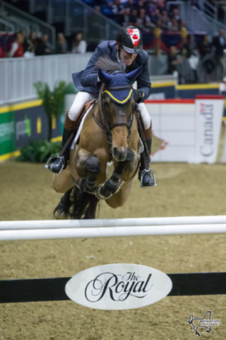 Ian Millar of Perth, ON, riding Dixson is on track to win his record 12th Greenhawk Canadian Show Jumping Champion following the opening round of competition on Friday, November 4, at the Royal Horse Show in Toronto, ON. Photo by Ben Radvanyi Photography (CNW Group/Royal Agricultural Winter Fair)