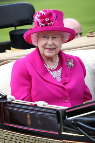 Queen Elizabeth II wears brooch designed by Canadian jeweller, Hillberg & Berk at 2014 Royal Ascot on June 20, 2014, in England. A budding favourite of The Queen, the brooch was presented to Her Majesty in October 2013 by Saskatchewan Lieutenant-Governor Vaughn Solomon Schofield. (Getty Images) (CNW Group/Hillberg & Berk)