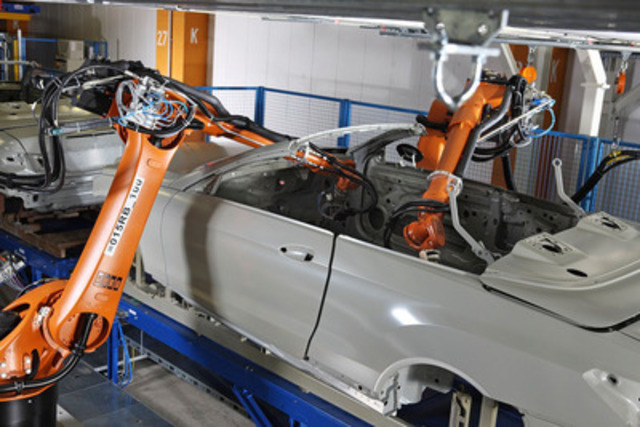KUKA Systems' new SAM robotic cell applies an acrylate sound-proofing compound that replaces heavier bitumen or butyl mats that have to be custom-cut and hand-positioned - one of two new technologies from KUKA to improve the efficiency and environmental performance of carmakers. (CNW Group/KUKA Systems Corporation North America)