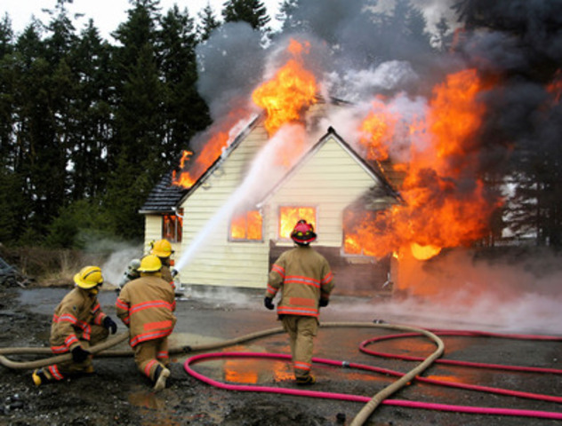 Firefighters battle a house fire. Fire Prevention Canada reports that an average of eight Canadians die each week as a result of fire. (CNW Group/Roxul Inc.)
