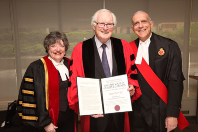 Julian Porter, QC, (centre) holds the Doctor of Laws honoris causa degree presented to him by The Law Society of Upper Canada at the June 23rd Call to the Bar ceremony at Roy Thomson Hall in Toronto. Treasurer Janet Minor (left) and Associate Chief Justice Frank Marrocco (right) congratulate him. (CNW Group/The Law Society of Upper Canada)