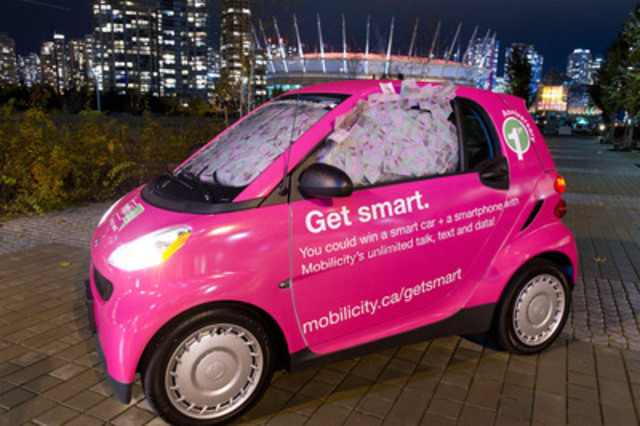 Mobilicity is giving Vancouver (shown) and Ottawa consumers the chance to win a smart car and smartphone for a year by guessing how much Mobilicity money is inside its smart cars. The wireless company is celebrating its one-year anniversary and showing how much the cities can save if everyone switched to Mobilicity. mobilicity.ca/getsmart. (CNW Group/Mobilicity)