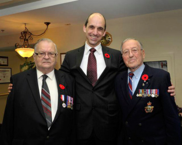 Minister of Veterans Affairs Steven Blaney and the Honourable Gilles Lamontagne (R) paid a visit to Veterans at Maison Paul-Triquet in Québec City in honour of Veterans' Week. They were accompanied by Veteran Albert Thériault (L) (CNW Group/Veterans Affairs Canada)