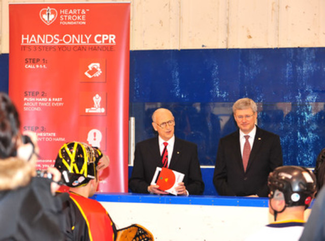 Heart and Stroke Foundation receives $10 million from Government of Canada to place life-saving AEDs in arenas across Canada (Dr. Doug Clement, Chair of the Heart and Stroke Foundation and Prime Minister Stephen Harper) (CNW Group/HEART AND STROKE FOUNDATION)