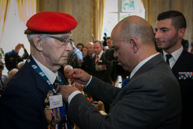 Canadian SWW Veteran, Havelyn Chiasson, receives France's highest decoration, the Légion d'honneur, at a ceremony today in France. France's Minister for Veterans, Kader Arif, presented the prestigous awards to eight Canadian SWW Veterans. The Honourable Julian Fantino, Canada's Veterans Affairs Minister, attended the ceremony. (CNW Group/Veterans Affairs Canada)