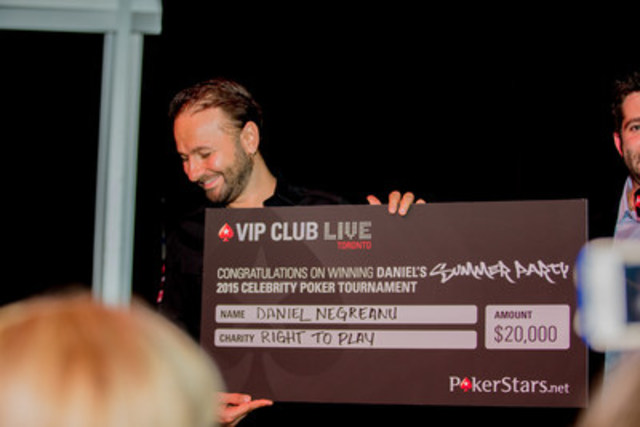 Canadian poker legend Daniel Negreanu wins a charity poker tournament and collects $20,000 for Right To Play. Nearly 800 Canadian poker fans packed into Real Sports Bar and Grill in Toronto to watch the action as Negreanu took on other celebrity players including sportscasters Bob McCown and Gregg Zaun and NHLer Phil Kessel. (CNW Group/PokerStars.net)