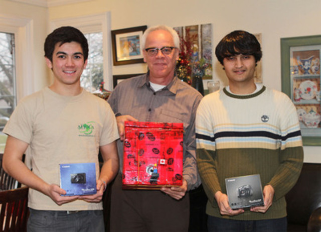 Wayne Doyle, Senior Manager, Corporate Communications at Canon Canada, congratulates Toronto teens Mathew Ho and Asad Muhammad with new cameras in Toronto, Ontario, upon hearing the success of their story that sent a Lego passenger 80,000 feet above the Earth into space.(CNW Group/Canon Canada Inc.)